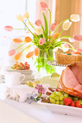 Table set for spring featuring flowers and ham