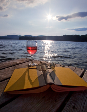 Glass of wine by the lake