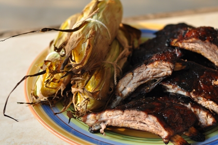 Grilled ribs and corn on a platter